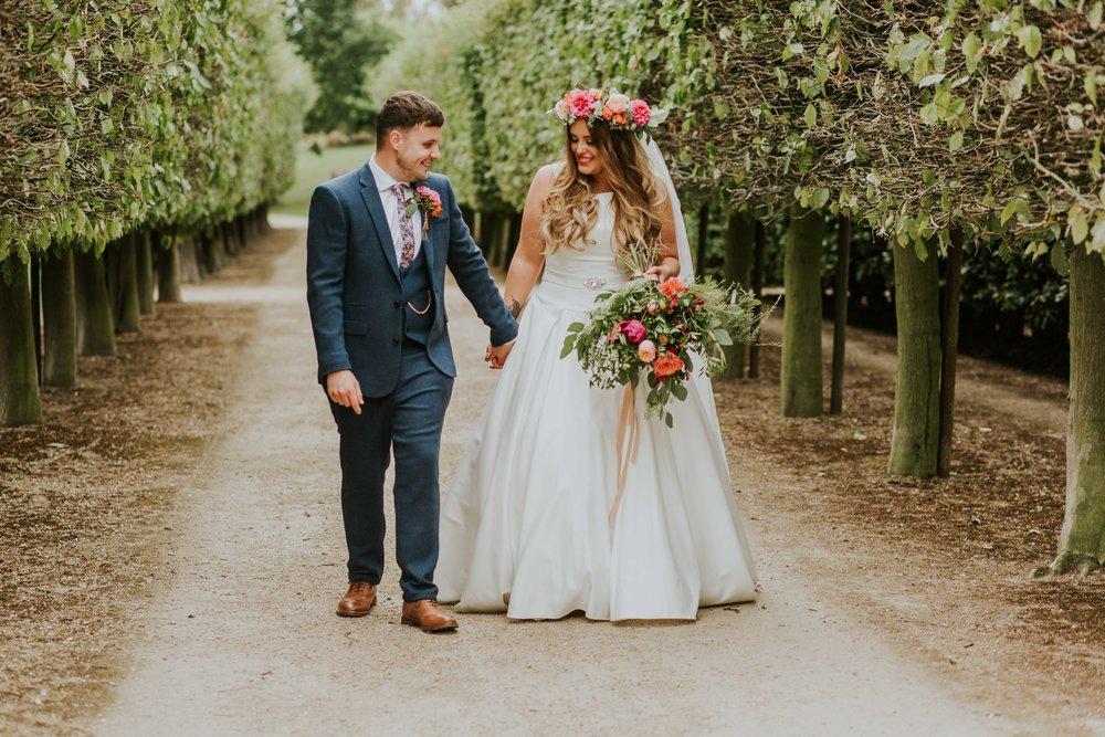 bride and groom walking together Leeds
