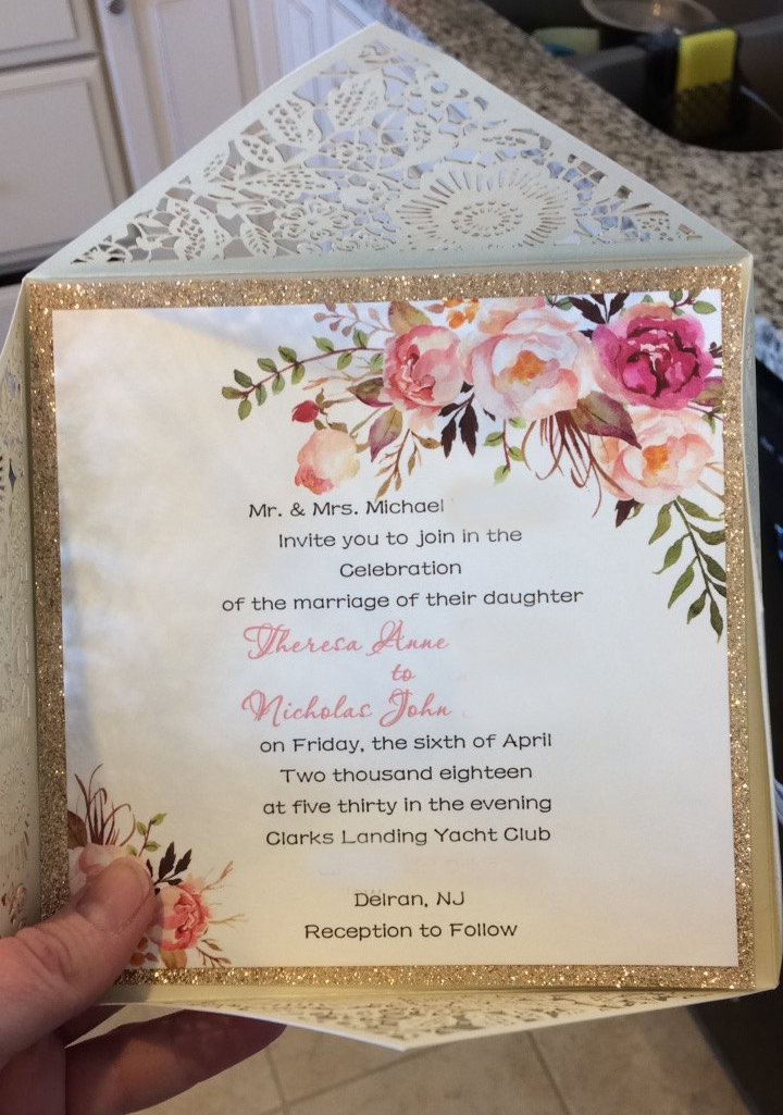 How pretty is this invitation!? Gold, flowers, and that envelope…yes, please!