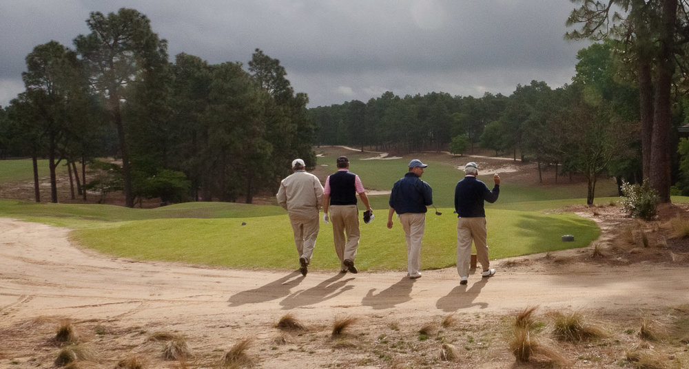 Not a golf cart in sight as Bob Dedman, JIm Hyler, Mike Davis and Bill Coore leave the fourth tee at Pinehurst No. 2 during the spring of 2011. (John Gessner photo)