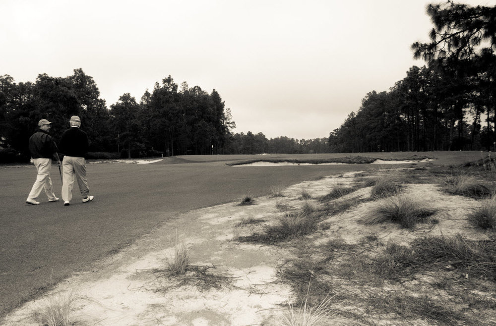 Pinehurst No. 2, one of the quintessential walking courses, as Mike Davis of the USGA and architect Bill Coore experience in 2011. (John Gessner photo)