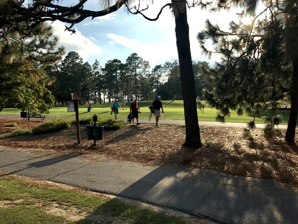 """Twilight is nigh as members of Pinehurst Country Club leave the ninth tee during a Tuesday afternoon """"Executive Golf"""" outing."""