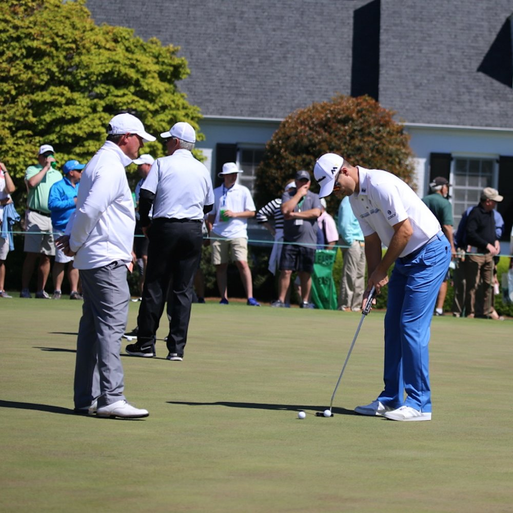 David Orr watches Justin Rose on the practice green at a recent Masters Tournament.