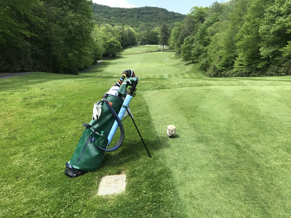 The view from the thirteenth tee, downhill off the tee, then across the Linville River and back uphill into the green.