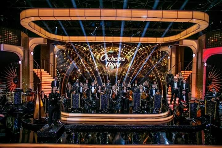 Dancing With The Stars 2019 - Week 8 of the smash hit show Dancing with the Stars had a very special guest in the shape of our front man, Gary Harpur. It was Orchestra Night and in a bit of a diversification form the usual set list, he performed four songs to a studio and live TV audience.Click on the below link to see him open the show with the David Bowie classic, 'Let's Dance'.https://youtu.be/-ntYM-FrydYOf course, it's not the band's first association with the RTE Concert Orchestra. The guys were accompanied by them on The Late Late Show performing Live and Let Die and Video Killed The Radio Star to great acclaim.