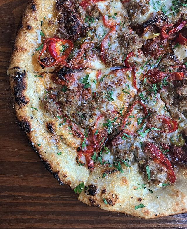 Our Fennel Sausage pizza got a bit of a face lift. Crumbled pork sausage, pickled peppers, fontina, ricotta, and confit tomato. Your East Coast friends will be jealous. #pizzaporn #ttpizza #eeeeeats