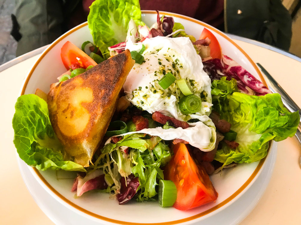 Salad with fried goat cheese and poached egg