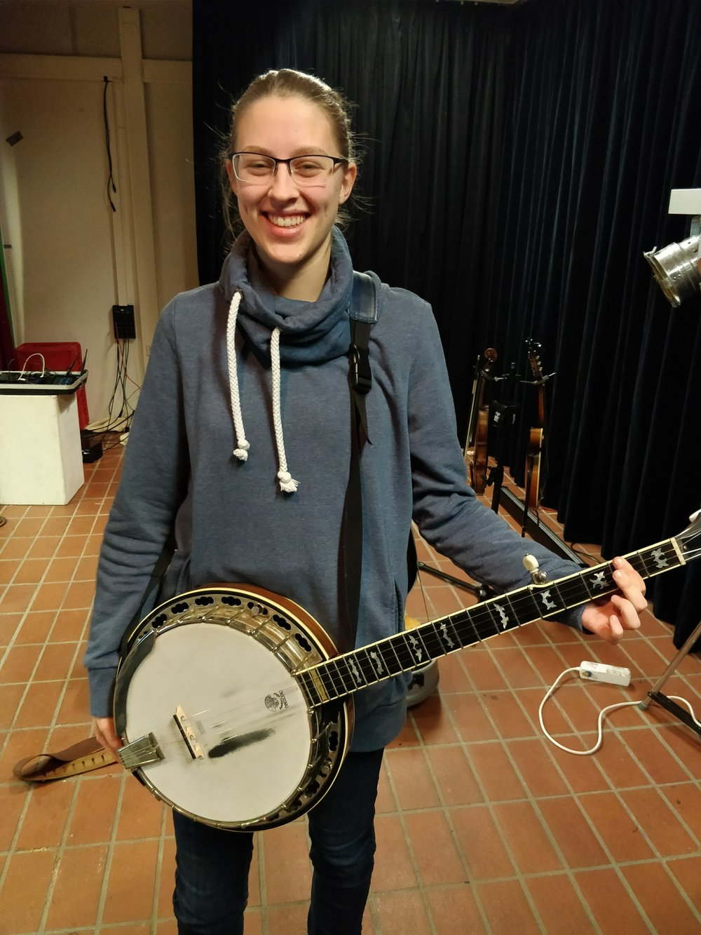 A young musician wanted to try Ben's banjo.