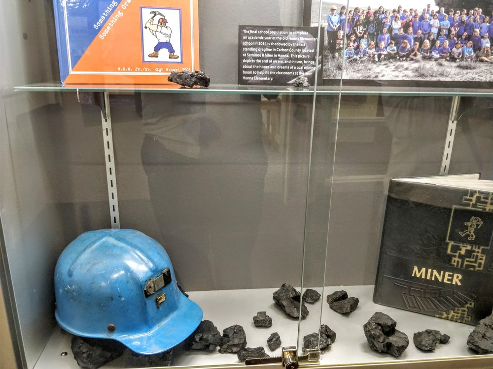 "Coal, a helmet, and yearbooks from the school. Naturally, the school mascot is the ""Hanna Miners""."