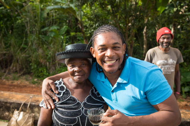 Here is a picture of Charles enjoying a cup of coffee with one of our farmers, Merisier Mariane.