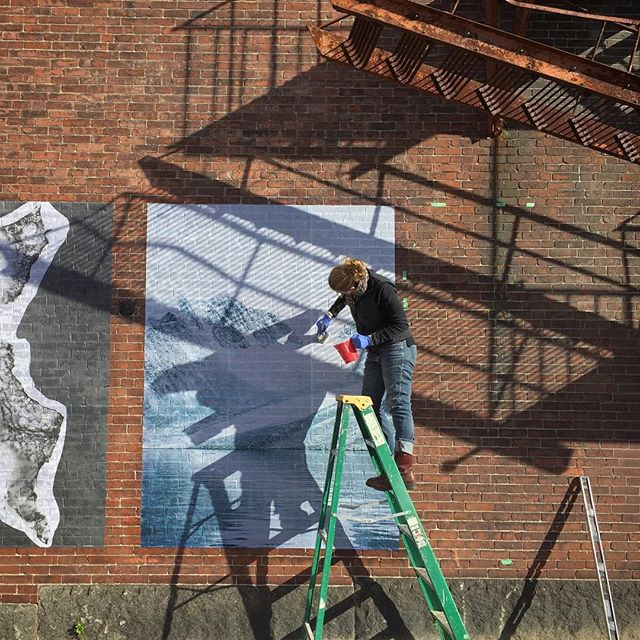 a new @chattermarkproject - in the process of going up in #biddefordmaine  thank you @tonee_harbert for the photo and @pepperellmillcampus @kindlingfund & @space538 for supporting this project! . . . #chattermarkproject #arctic #glacier #glacierice #wheatpaste #photogram #mural