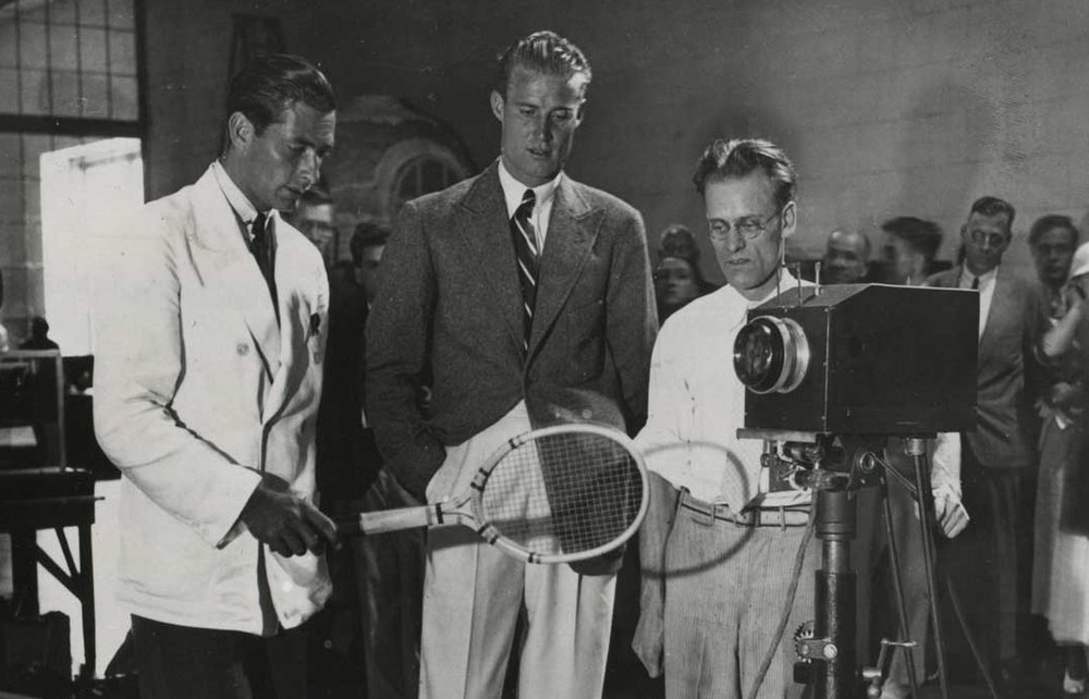 In this rare photograph from 1934, Farnsworth (on the right behind the camera) shows the strain of keeping the demonstration television system operational while programing enough material to televise for the entire 10-day run of the exhibition.