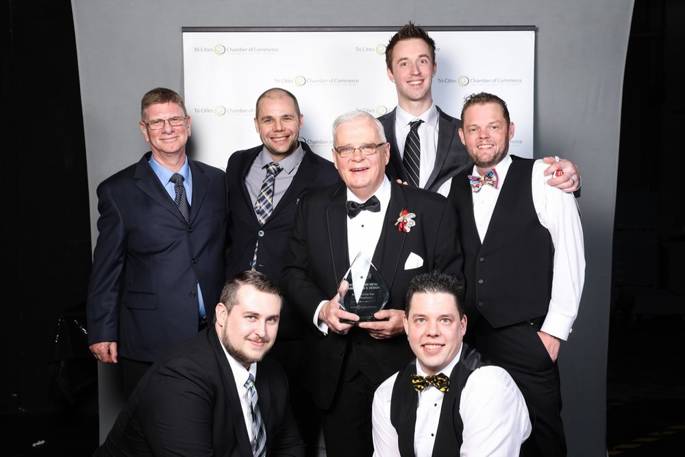 The Dion team with their Tri-Cities Chamber of Commerce Business Excellence Award for 2016 Small Business of the Year.