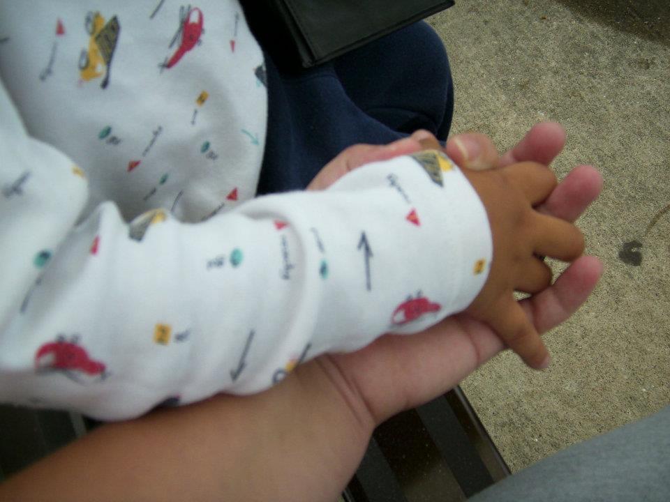 My nephew, Saadiq's, hand holding mine.