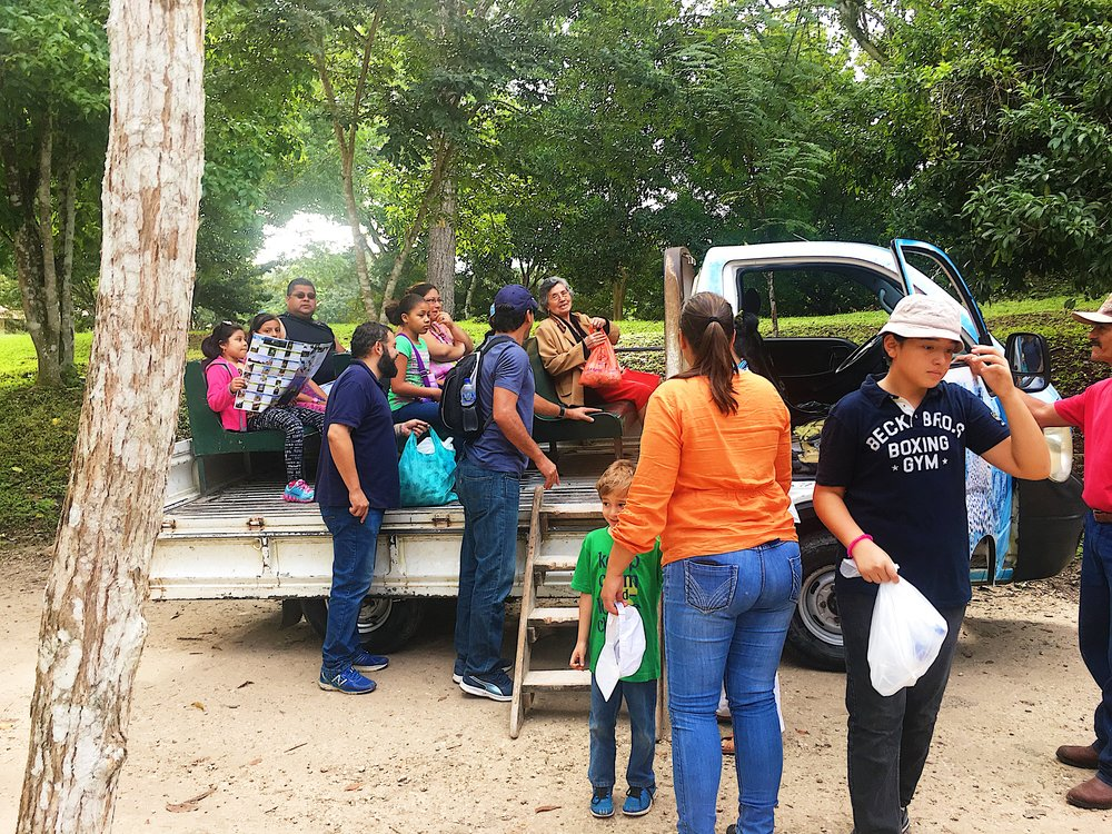 A pick-up truck with comfy make-shift seats helps to transport those who are unable to hike the trails in Tikal National Park.