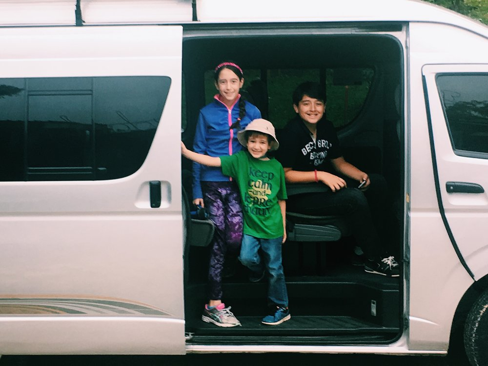 Little travelers in their van on the way to visit the Mayan ruins of Tikal National Park.