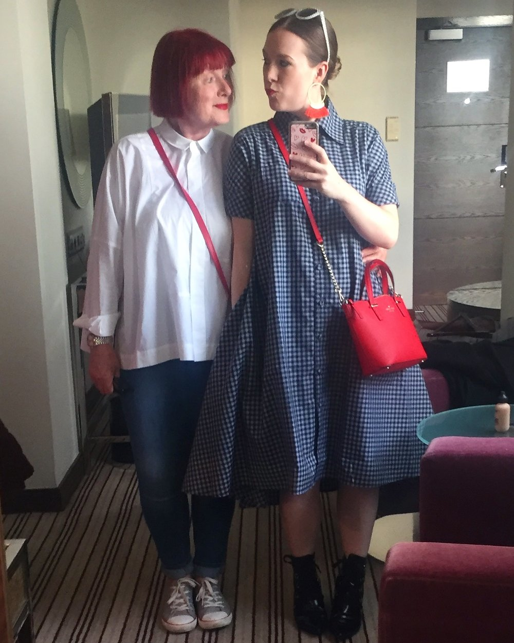 My mother Sally and me in a hotel in London. Matching purses of course.