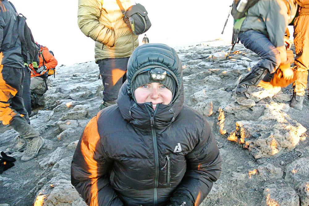 Gretchen in Arctic gear and headlamp on a mountain