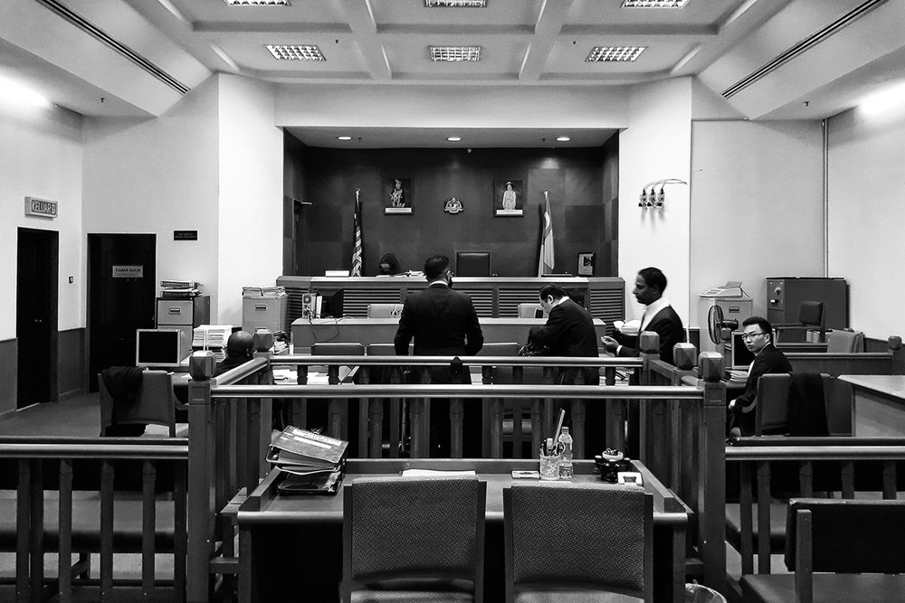 Solicitors prepare before an immigration hearing in Kuala Lumpur. The solicitors are defending the immigration status and detention of a 16-year-old stateless Rohingya boy.