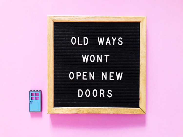 old-ways-won-t-open-new-doors-great-quote-on-black-letter-board-blue-lego-doors-pink-background_t20_WxL9OK.jpg