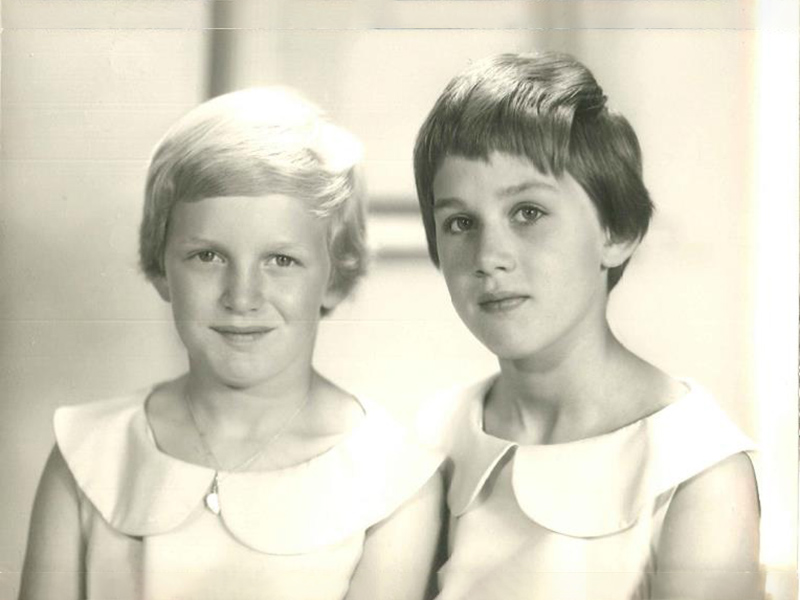 Celia and her sister, Dinah, in matching dresses.