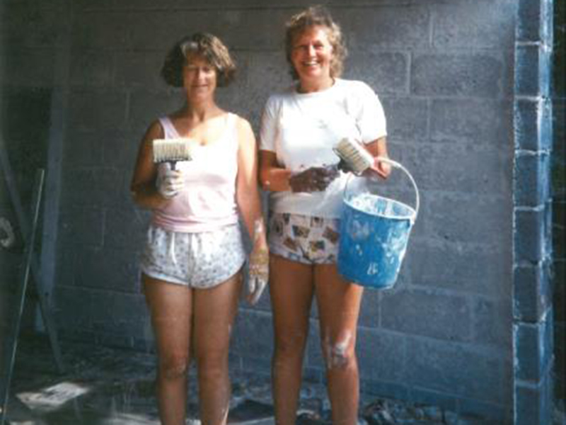 Celia and Diana painting their house in 1990