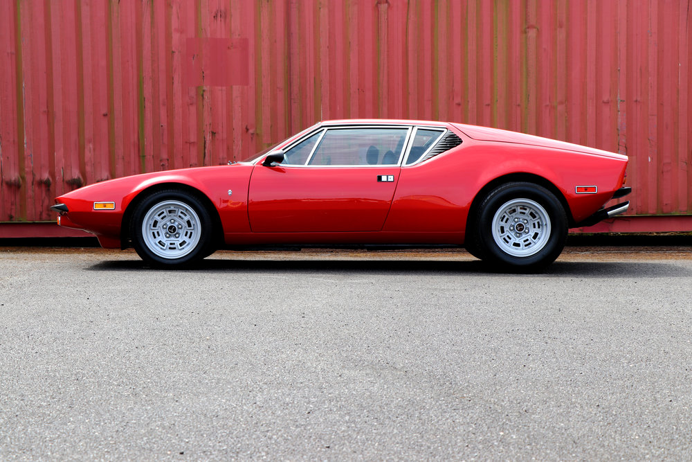 Fully restored 1974 De Tomaso Pantera GTS in red, at Three Point Four.