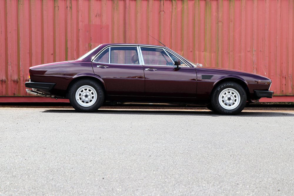 Fully restored 1982 De Tomaso Deauville Series 2 in burgundy, for sale at Three Point Four.  Right hand drive, Ford Cleveland V8 engine, a classic luxury sedan from De Tomaso.