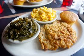 Fried fish, collard greens, macaroni and cheese and a cornbread muffin are staples of soul cuisine.