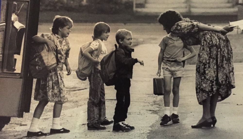 Shirley Stewart greeting students at Randolph Elementary School - 1990                         Credit (Herald/Bob Eddy)