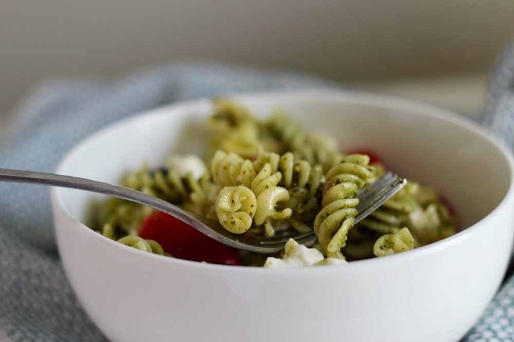Pesto Pasta Salad - 1 pint of grape tomatoes1 can of large black olives8oz. of fresh mozzarella pearls1 box of rotini pasta*1 C pesto 1. Cook pasta according to package for al dente noodles**2. Cut the tomatoes and olives in half and place into a bowl3. Once pasta is cooked add everything into the same bowl4. Once the pasta cools a bit, add the mozzarella pearls5. After all ingredients are added toss in the pesto and either serve warm or chill for a couple hours.* We used GF, because my sister has sensitivities to it.**When making a pasta salad you want them to be a little more on the al dente side, because it soaks in sauce normally. If your using GF noodles like we did, cook them till they are like you would eat them with sauce, nice and soft. They don't soak down like regular noodles do as well.