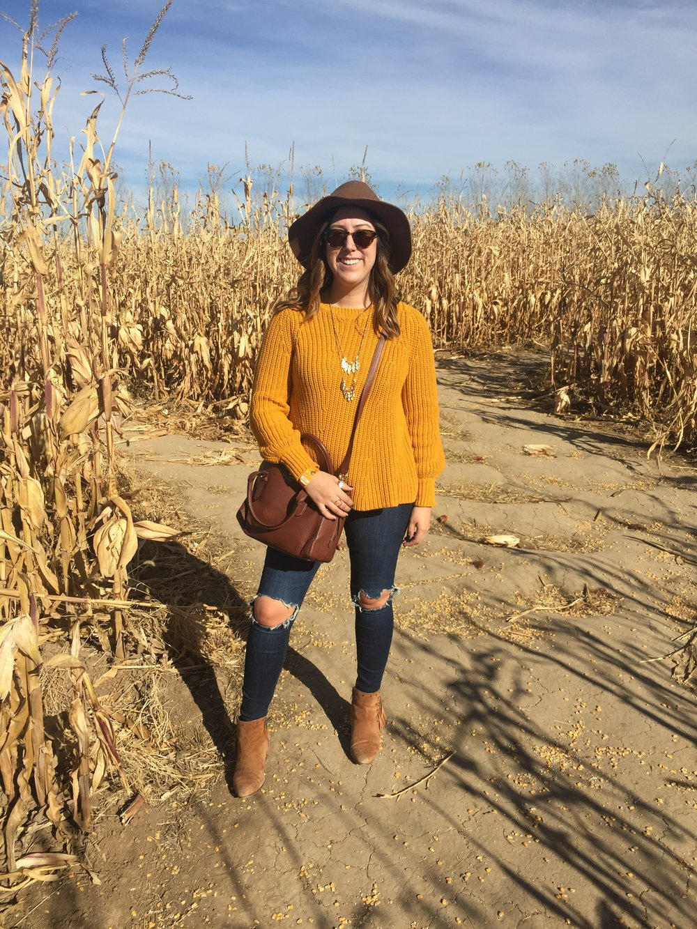This outfit gives me all the fall vibes! Pairing this sweater with fringed suede booties, a floppy hat and a layered leaf necklace was the perfect choice for the corn maze!