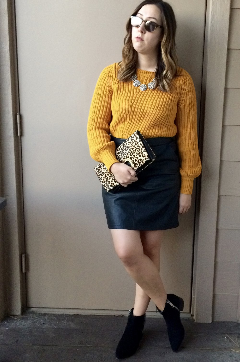 This would be perfect for a date night or happy hour with the girls! I half tucked this sweater into the skirt, paired it with black booties and added a leopard clutch to add a fun pop to the outfit. Mustard and leopard pair together perfectly!