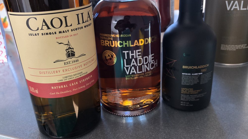 Caol Ila and Bruichladdich bottles