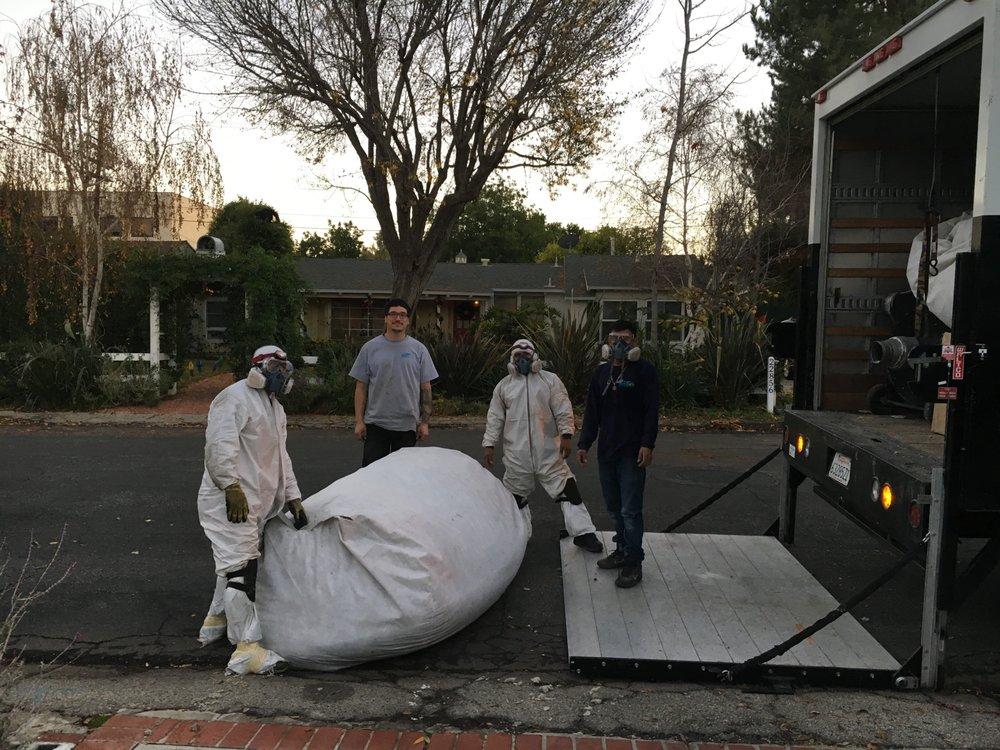 Home Loans San Fernando Valley with Stella Croxon Bagging the attic.jpg