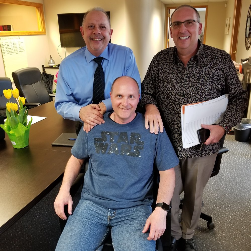 Back: Otto Alcon, Geneva Financial, LLC and Robert Meldrum Century 21 Collins Michigan Home Loans Front: Gary W., happy new homeowner!
