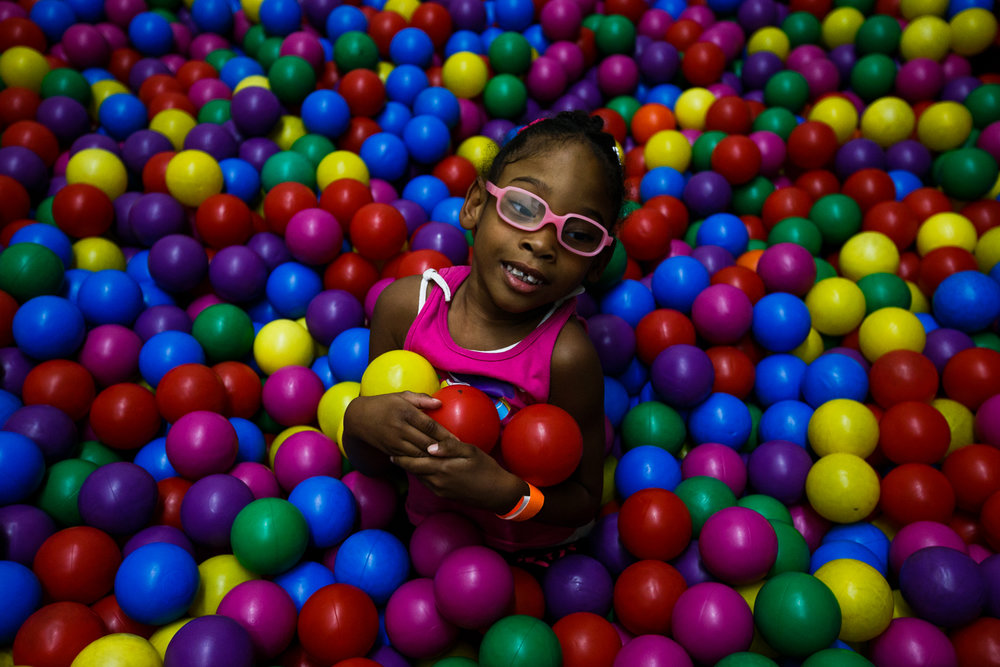 "05 August 2014, Yakima, Wash. --- Gabriela Downing, 4, plays in the ball pits at Kid's Castle. As a form of physical therapy for her spina bifida, Gabriela's parents bring her to the play area once week. Jacobie Downing says, ""Really though, the main reason why we bring her there is to make her feel that she can grow up living a normal kid's life."" (Copyright Yakima Herald-Republic)"