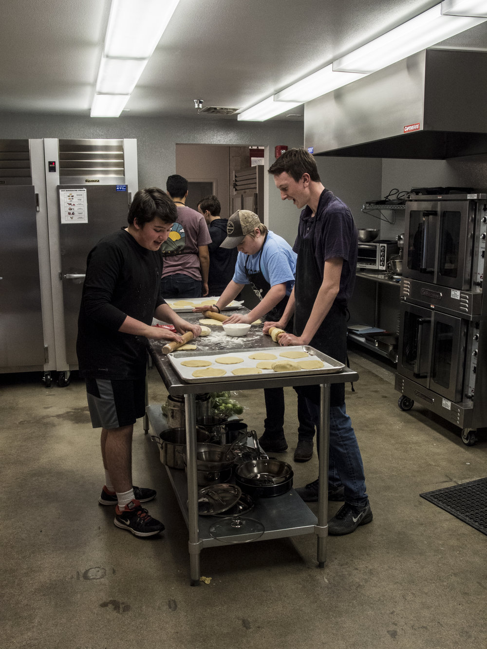 Solution Lab students use the industrial kitchen to make homemade pies to sell at community events.