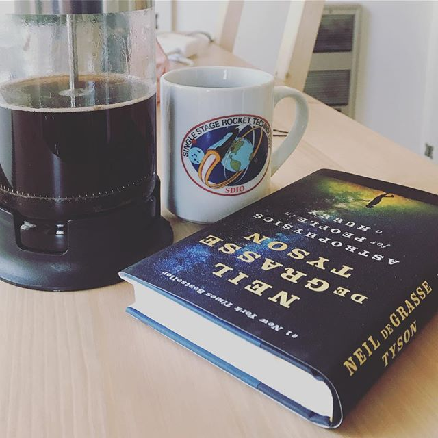 I'm caffeinated and I'm ready for my rocket. I waited so long to savor this book, but ended up reading it in an afternoon. It does say it's for people in a hurry... 🚀💫 #thebookshipproject  #neildegrassetyson