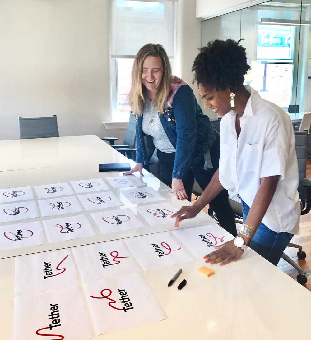 Designer Hannah Williams and I go over options for the Tether logo. Anything look familiar?