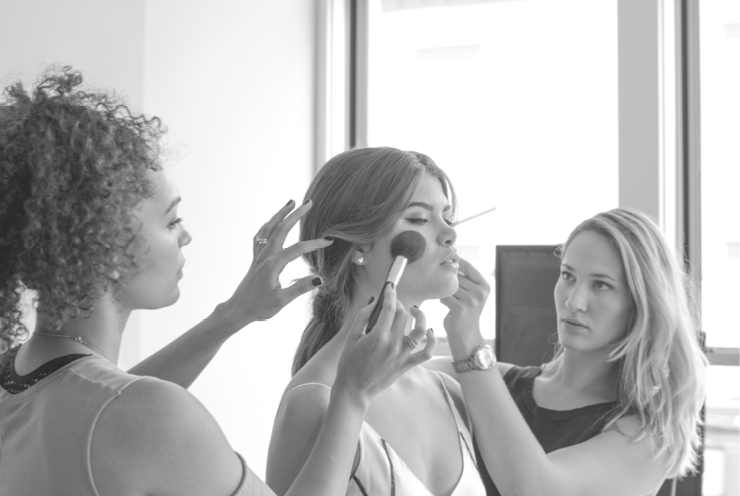 Makeup artist Laura Vega, model Emma Karle, and hair stylist Tara Tussing Wood