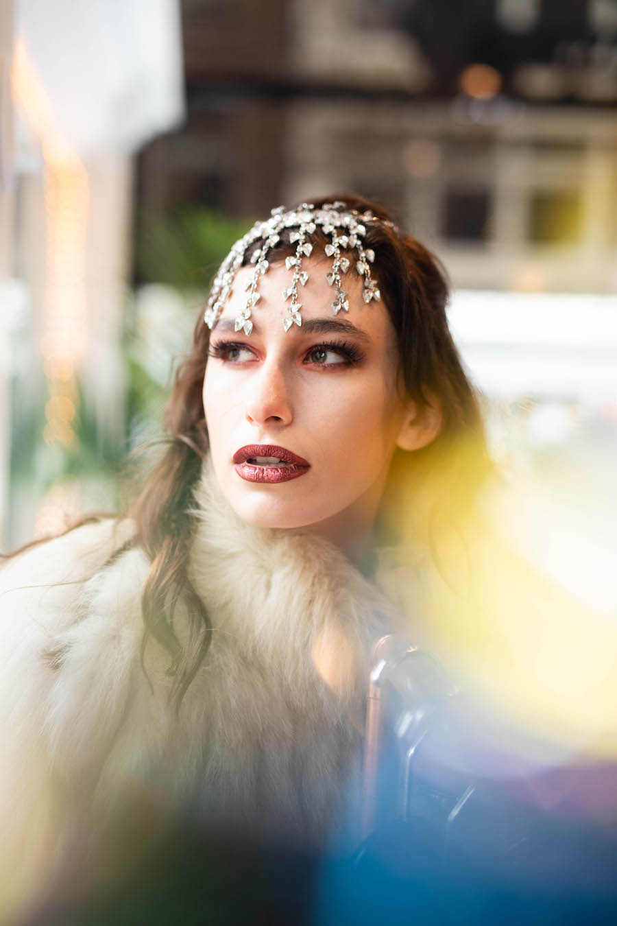 """""""I grabbed a piece of rainbow tinsel off of our tree right before leaving the house for the shoot, and used it to shoot through and create some fun colors in the frames."""""""