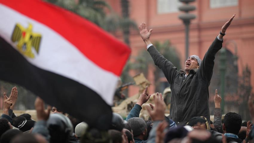 Demonstrators protest the regime of Hosni Mubarak in Tahrir Square, Cairo