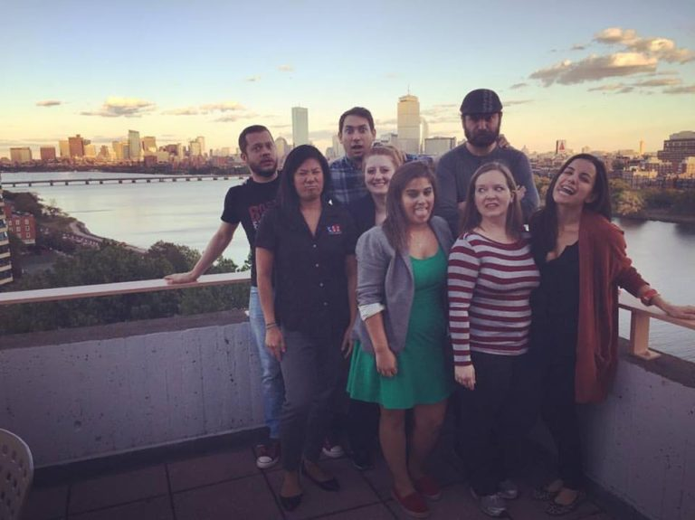 Family photo of the roadshow team, overlooking the beautiful view of the city from the Hyatt ballroom [Photo credit: Joseph Gels]