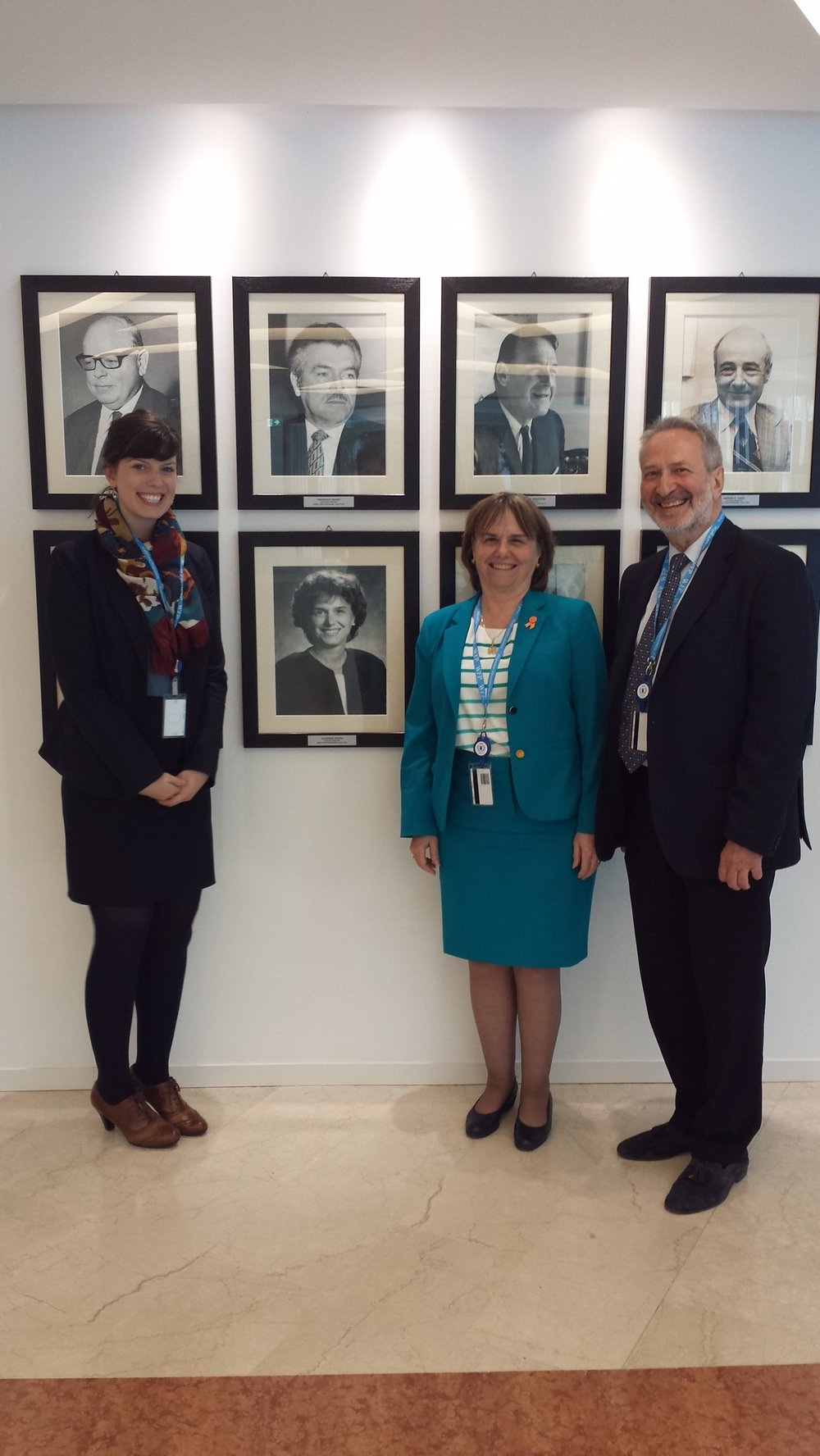 In a 2015 visit to Rome, Catherine Bertini posed for a photo next to the gallery of executive directors. She is joined in this photo by Emily Fredenberg, WFP Lebanon, and Werner Schleiffer, retired WFP staff member and current director of the Syracuse University Geneva Summer Program.