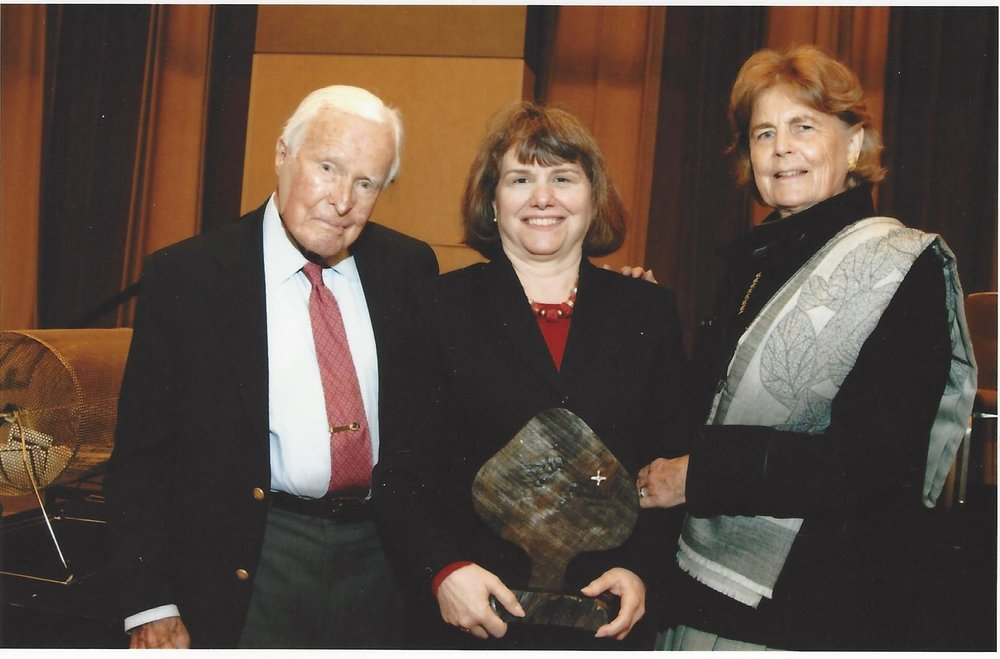 Catherine Bertini holds the Brigid Award with her dear friends Ambassador Robert and Mrs. Lillan Stuart (2010)