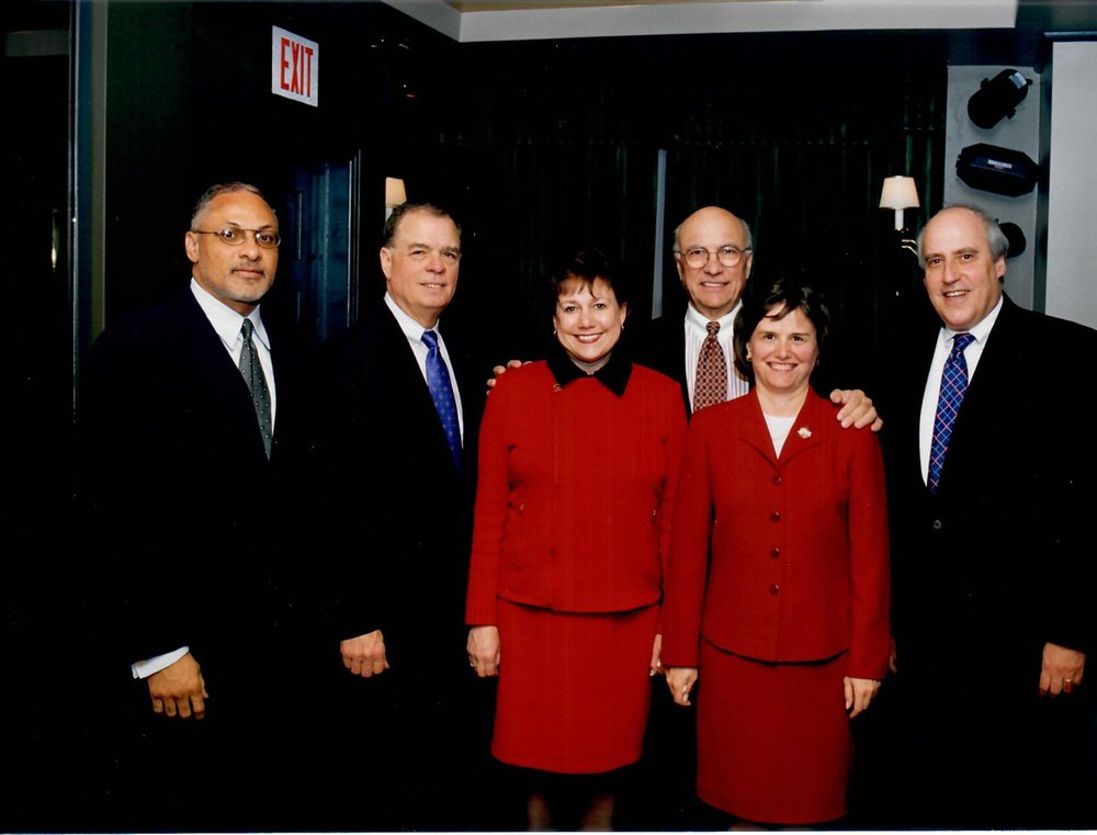 Catherine Bertini stands with current and past USDA Secretaries: Mike Espy (Clinton), Jack Block (Reagan), Ann Veneman (George W. Bush), Clayton Yeutter (George H.W. Bush), and Dan Glickman (Clinton) (2002)