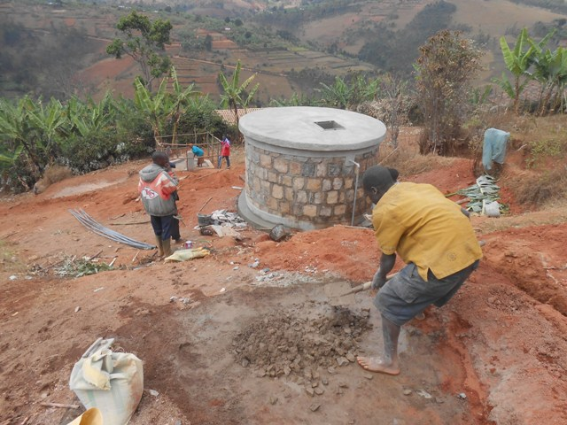 In the absence of modern construction equipment in rural areas, trenches are dug and tanks are constructed, all by hand.