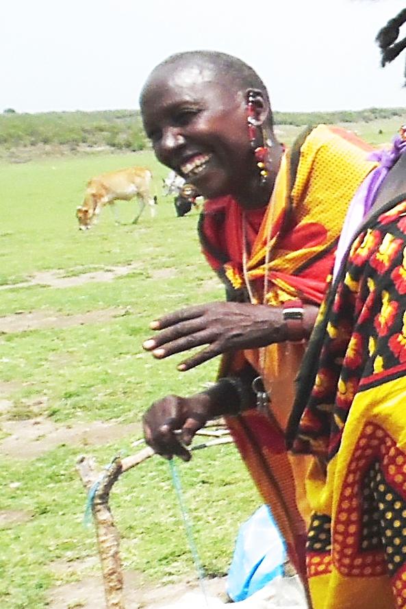 Maasai Woman Laughing at us.jpg