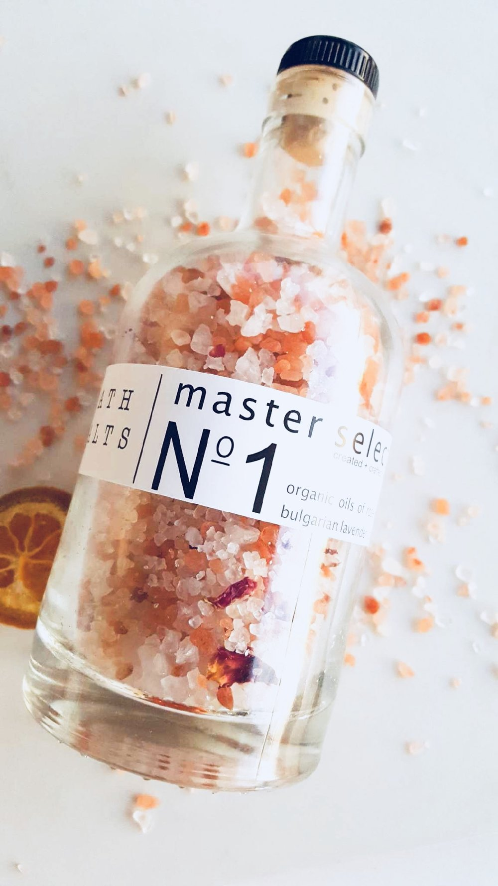 """Master Selection Bath Salt No. 1 - """"A blend of mineral-rich Mediterranean and dead sea salts along with Pink Himalayan Sea Salt make a relaxing and detoxifying soak, while organic botanicals create a luxurious spa experience in your tub. Our Pink Himalayan Sea Salt is sourced from deep within the pristine Himalayan mountains lending to the belief that Himalayan Pink salt is the purest salt to be found on earth. With sensual oils rose geranium, Bulgarian lavender, and patchouli."""""""