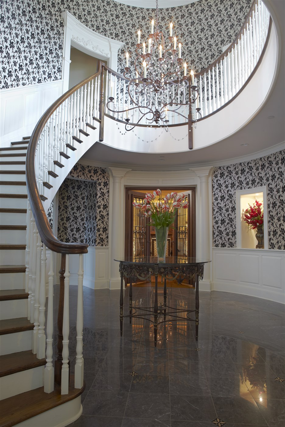 Wooden curve staircase with white railing